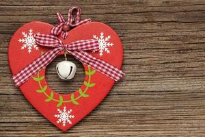 Valentijnsdag hart op houten achtergrond foto