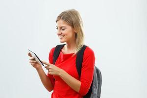 student met behulp van digitale tablet foto