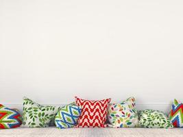 kleurrijke kussens bij een witte muur foto