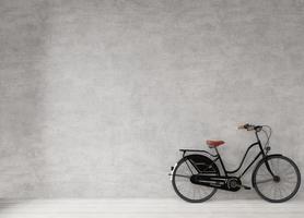 fiets tegen een betonnen muur foto