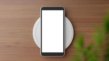 bovenaanzicht van een smartphone op een oplader