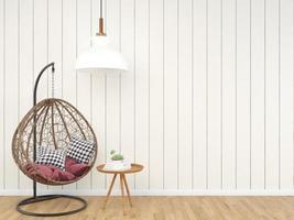 vintage neststoel in woonkamerhoek en boek foto