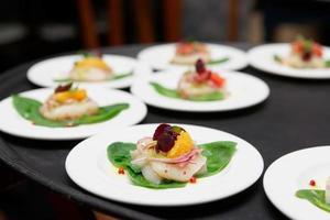 carpaccio gerechten van zeeschelp foto