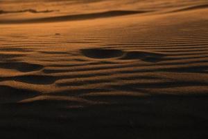 voetafdruk in het zand foto