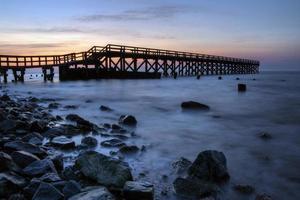 vissen pier zonsopgang foto