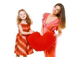 heldere stijlvolle vrolijke moeder en dochter in jurk foto