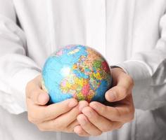 globe, aarde in de hand foto