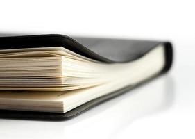 zwart lederen notebook, selectieve aandacht; vintage toonstijl