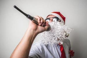 grappige kerstman babbo natale zingen foto