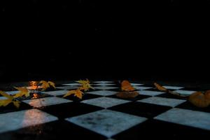 bladeren op een schaakbord