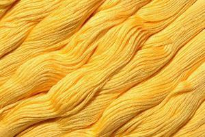 gele strengen floss als achtergrondstructuur