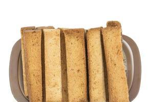 close-up van toast stokken op een plaat foto