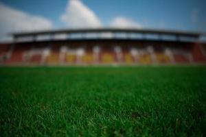 stadion achtergrond met een groen grasveld foto