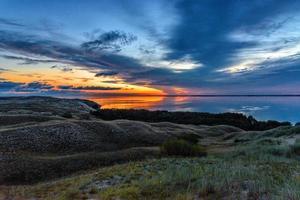 duinen bij zonsondergang foto