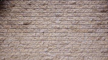 bruine rots steen naadloze textuur, achtergrond, stenen muren. zandsteen. stenen muur als achtergrond. geconfronteerd met steen .architecture ontwerp. voor photoshop .3d mapping achtergrond foto