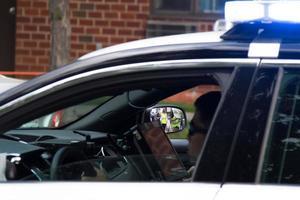 Verenigde Staten, 2020 - politieagent in auto foto