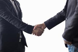 twee zakenlieden handen schudden foto