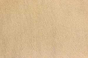 zand en strand voor textuur en achtergrond foto