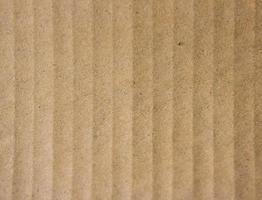 close-up van bruin geribbeld papier voor textuur of achtergrond foto