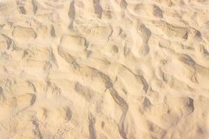 zand op het strand voor textuur of achtergrond foto