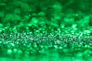 groene glitter bokeh achtergrond foto