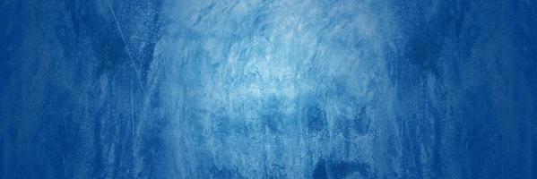 donkerblauwe cementachtergrond foto