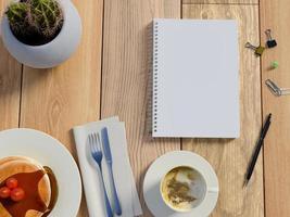 3D-weergave van bovenaanzicht op tafel met notebook foto