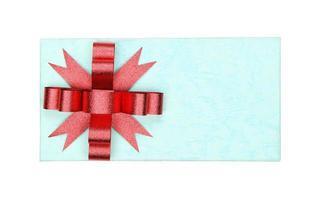 blauwe doos met rode strik foto