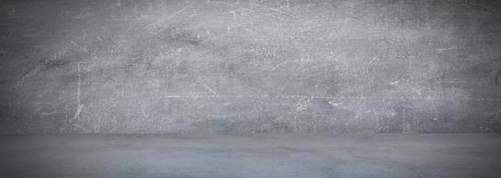 grijze cementmuur en studio ruimte banner als achtergrond foto
