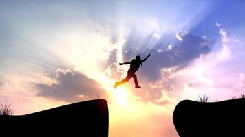 silhouet van een man springen op klif