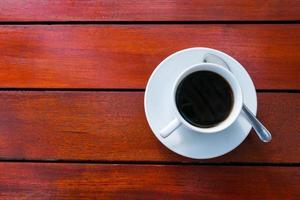 koffie op een houten tafel foto