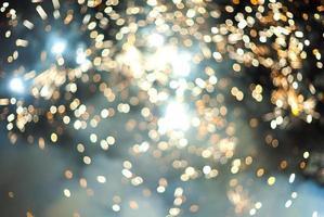 gouden bokeh lichten op een blauwe achtergrond