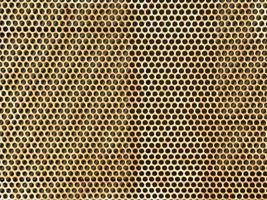 verroeste metalen plaat met gaten foto
