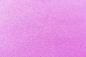 close-up shot van licht roze papier structuurpatroon voor achtergrond foto