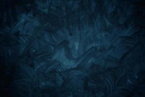 donkerblauwe cementmuur voor achtergrond of textuur