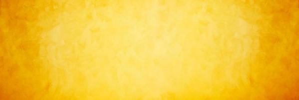 geel en oranje cement of betonnen muur voor achtergrond of textuur foto