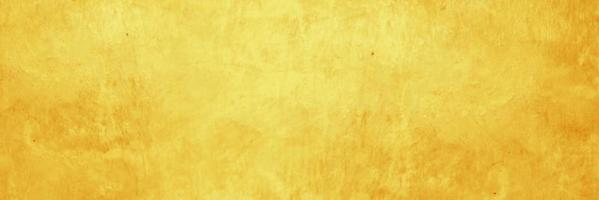 oranje en geel cement of betonnen muur voor achtergrond of textuur foto