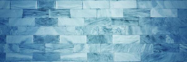 blauwe bakstenen muur voor achtergrond of textuur foto