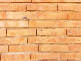 bakstenen muur voor achtergrond of textuur foto