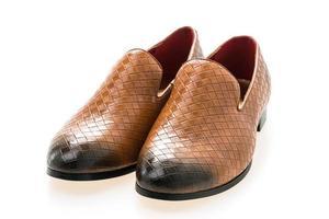 lederen schoenen op witte achtergrond