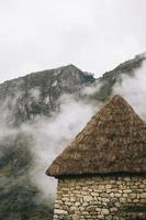 stenen huis in machu picchu, peru foto