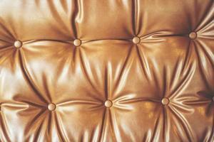 close-up van een leren stoel foto