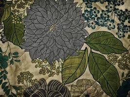 bloemmotieven op stof voor achtergrond of textuur foto
