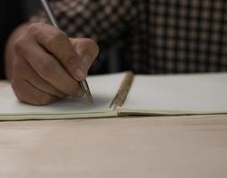 close-up schrijven met kopie ruimte, notitie en geheugen van het levensconcept foto