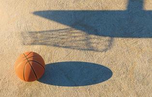 basketbal bal op betonnen vloer, 3D-rendering foto