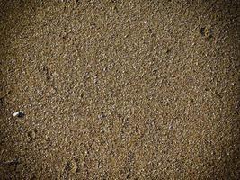 stukje zand voor achtergrond of textuur foto