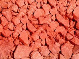 close-up van rode steen of rotswand voor achtergrond of textuur foto
