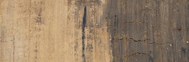 achtergrondstructuur van het gladde oppervlak van de aardbodem foto
