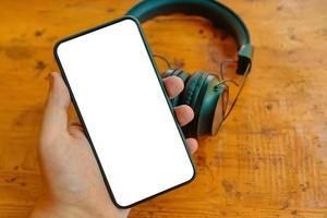 mobiele telefoon en draadloze hoofdtelefoons foto