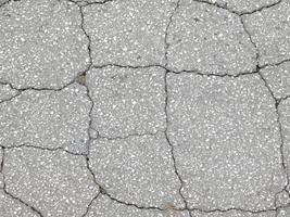 patch van gebarsten beton voor achtergrond of textuur foto